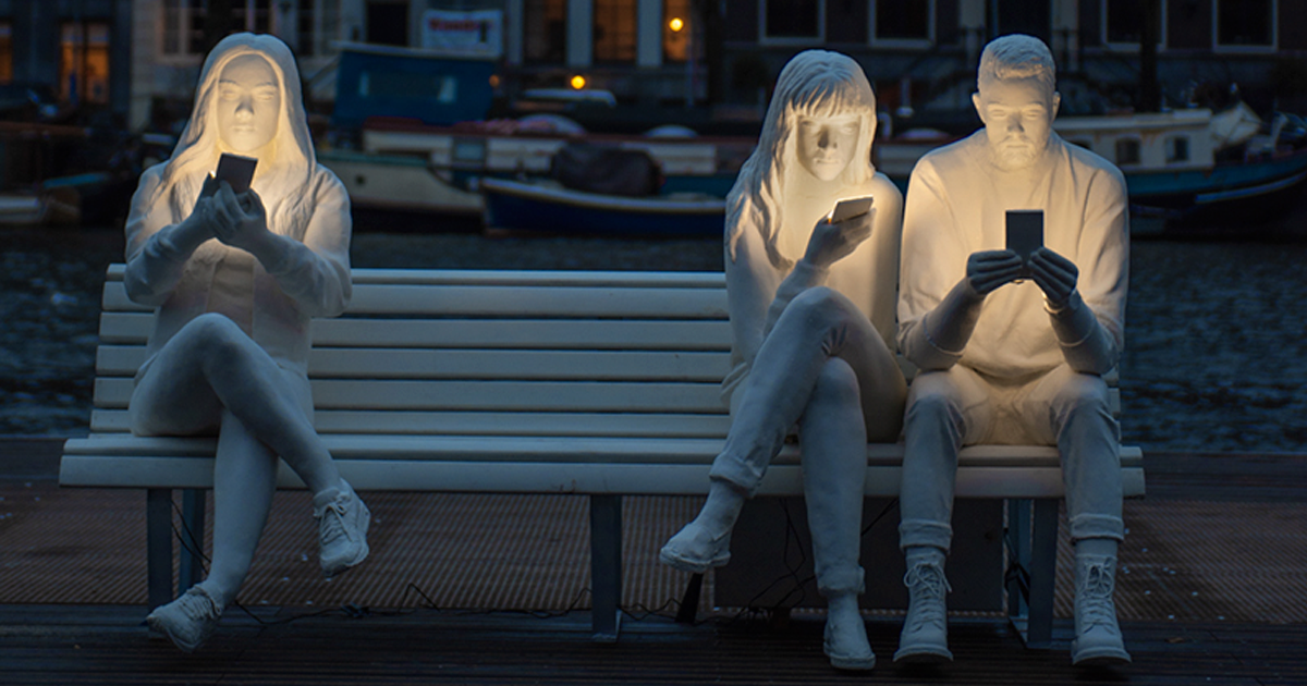 staring at phones statue