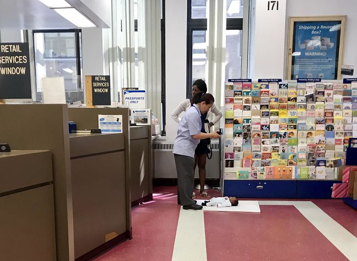 USPS Worker Taking Passport Picture For The Baby