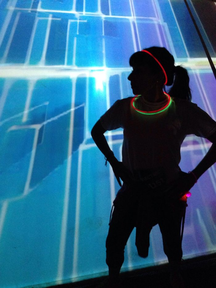 My Wife And I Recently Attended A Rave-Themed 5K Event. I Took This Picture Of Her Standing In Front Of A Light Board