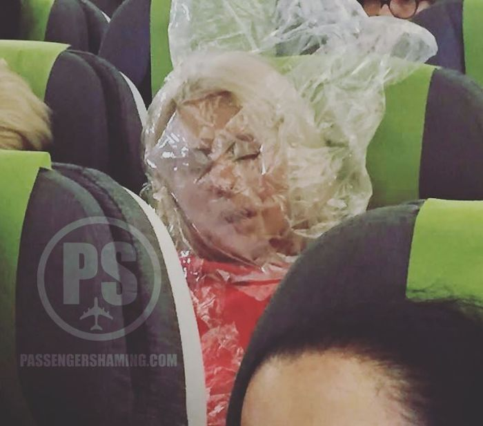 This Darwin Award Passenger Was Cold... So She Used The Plastic Bag (That Was Holding Blanket / Pillow) And Put It Over Her Head To Warm Up