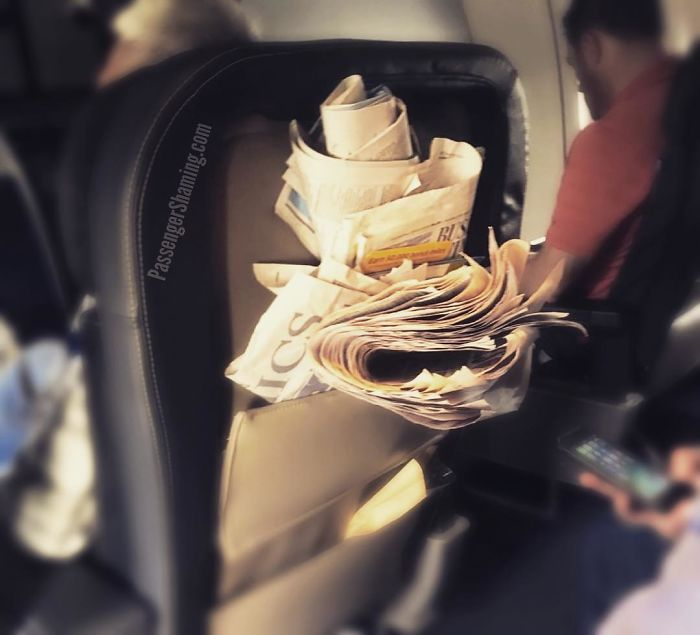This A**hat Is Evidently Finished Reading, And Doesn't Understand Why Flight Attendants Walk Through The Cabin With Trash Bags...