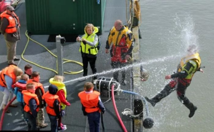 Kids Playing With Fire Hose During Coast Guard Demo
