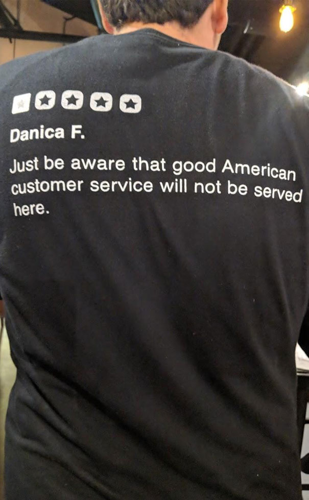 This Restaurant Wears 1 Star Yelp Reviews Behind Their T-Shirts