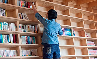 Japanese Architect Designs An Entire Home With An Inclined Wall For An Earthquake-Proof Bookshelf