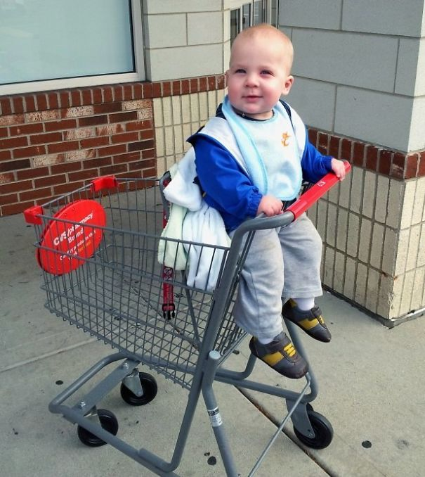 The Miniature Shopping Carts At The Local Pharmacy Make My 11-Month-Old Son Look Like A Giant