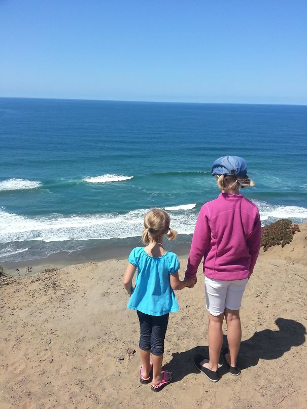 My Kids On A Cliff Looking At The Ocean Makes Them Look Like Giants