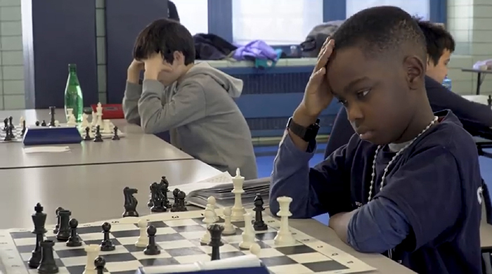 8 Year-Old Homeless Refugee From Nigeria Wins Chess Championship In New York