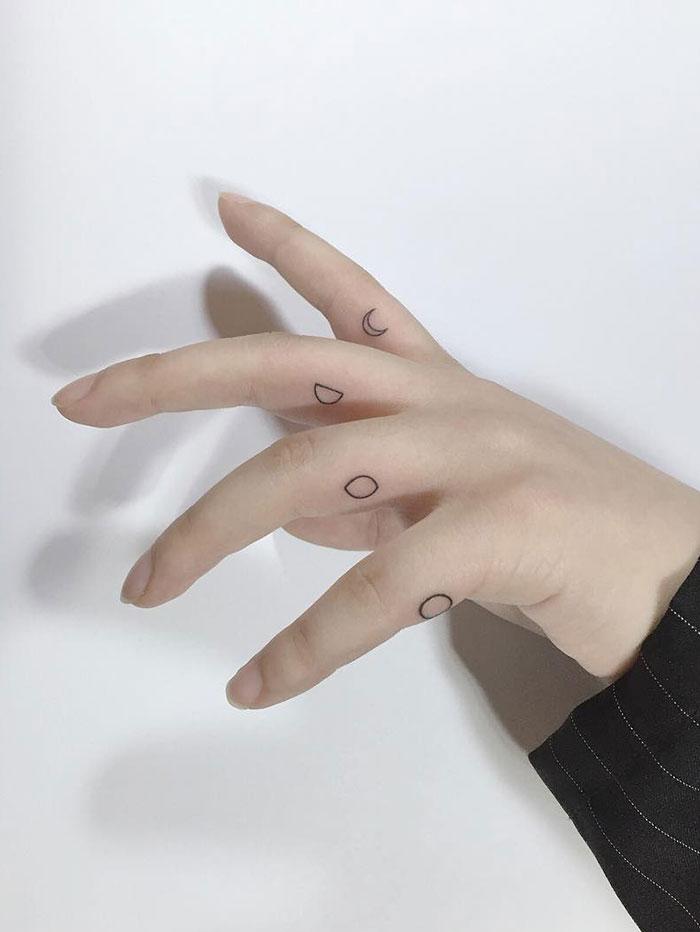 Minimalist Moon Finger Tattoos