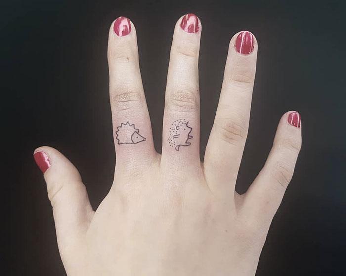 Adorable Hedgehog Finger Tattoos