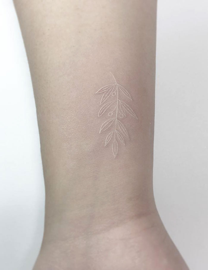 White Ink Olive Tattoo