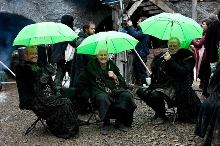 The Nights Watch Holding Umbrellas