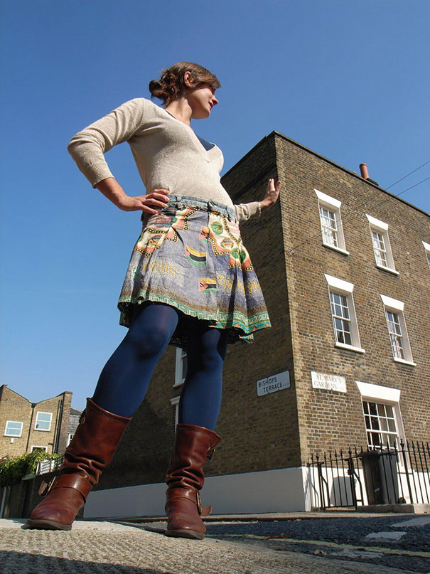 Giant Lady Leans On Building