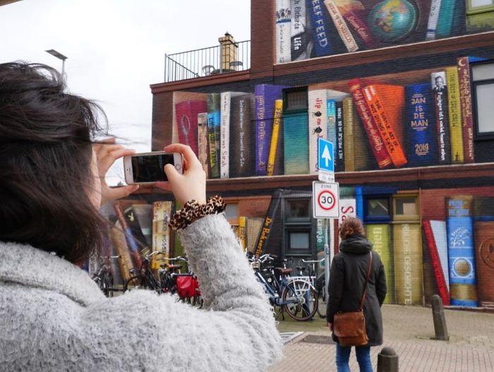 Dutch Artists Paint Giant Bookcase On An Apartment Building