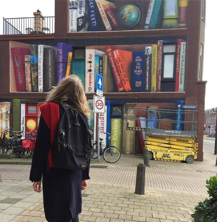 Dutch Artists Paint Giant Bookcase On An Apartment Building Featuring Residents' Favorite Books