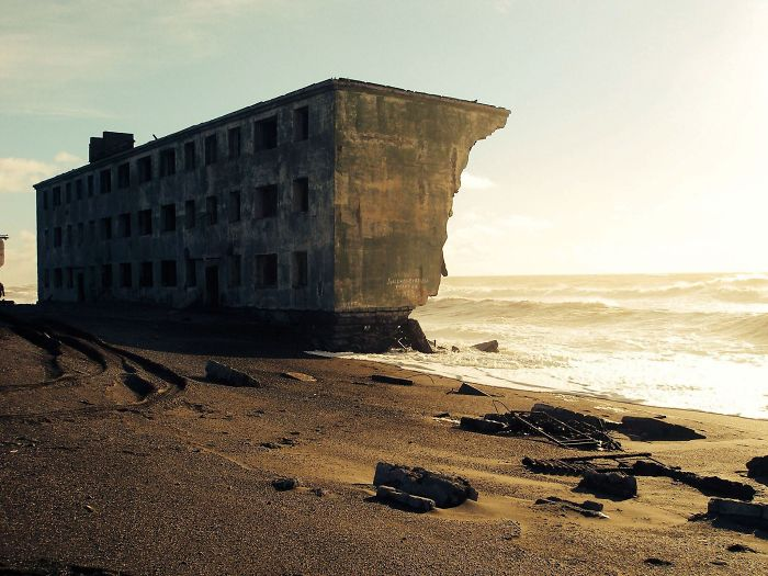 Abandoned Apartment Building Being Claimed By The Sea In The Former Fishing Village Of Kirovsky, Russia