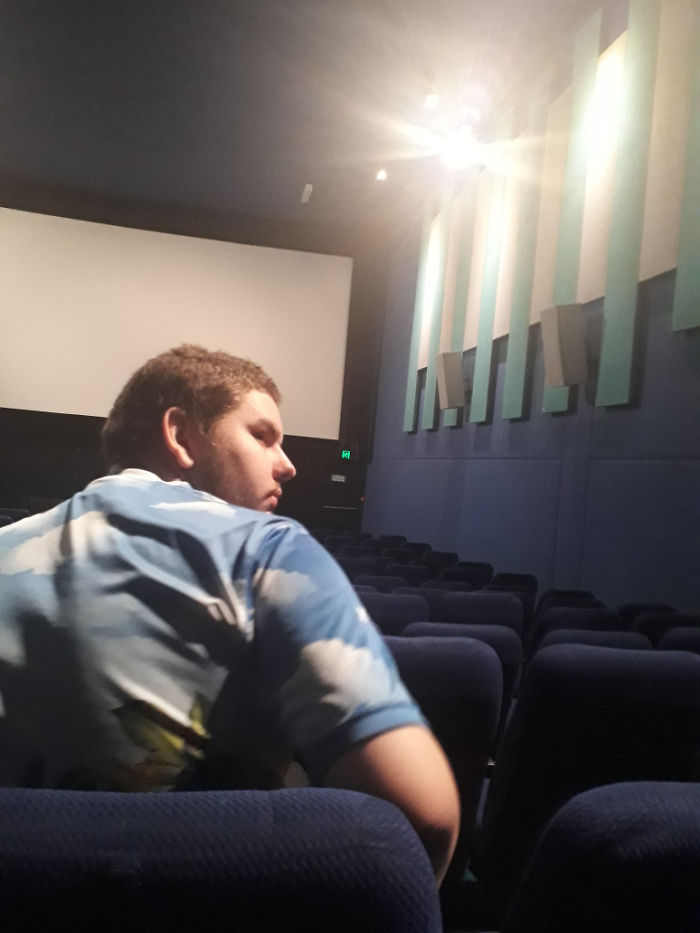 An Otherwise Empty Cinema And He Sits Directly Infront Of Me
