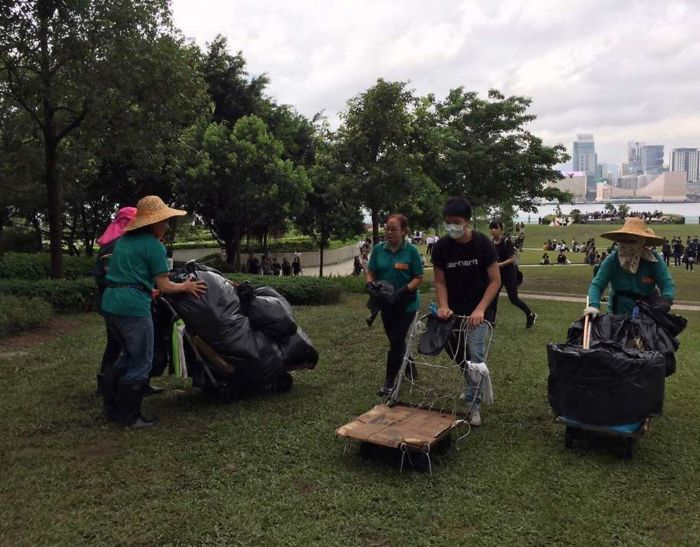 Hong Kong Protestors Cleaning Up The Field After The Protest