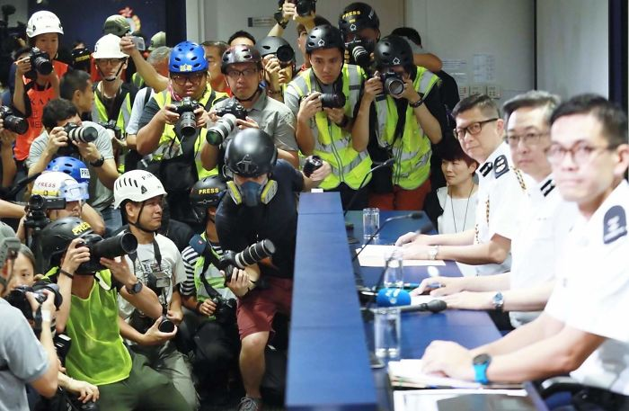 Hong Kong Press Wears Helmets, Eye Masks And Reflective Vests To Express Discontent Towards Local Police's Actions