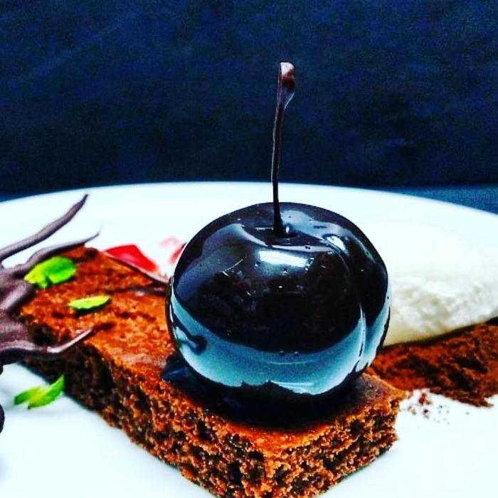 Chocolate Cherry Ganache,mirror Glazed And Served With Chocolate Sponge, Cream And A Cherry Gel