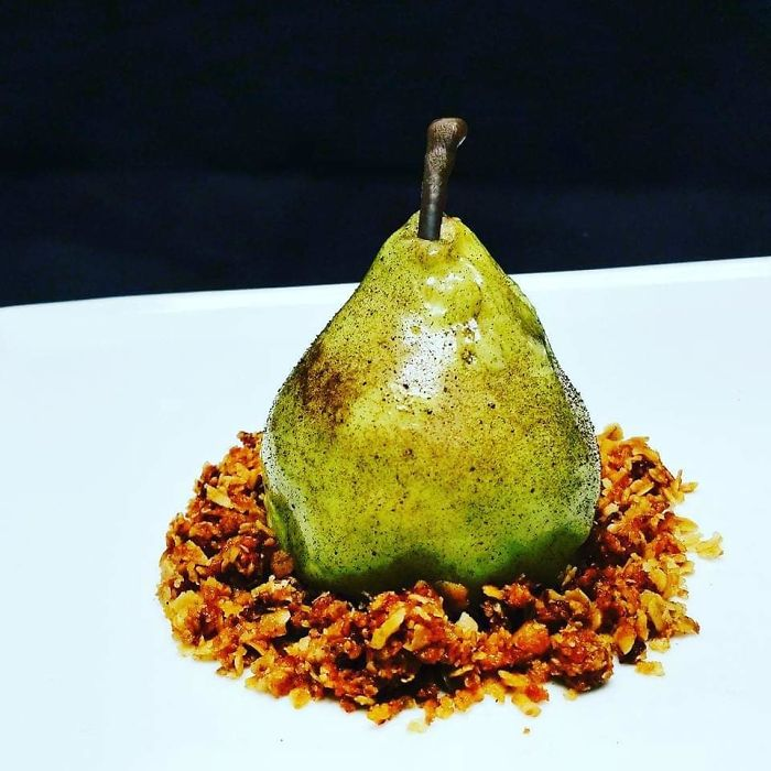 Pear Crumble. Pear Mousse, Filled With A Custard, Mirror Glazed And Flecked, Brown Butter Granola