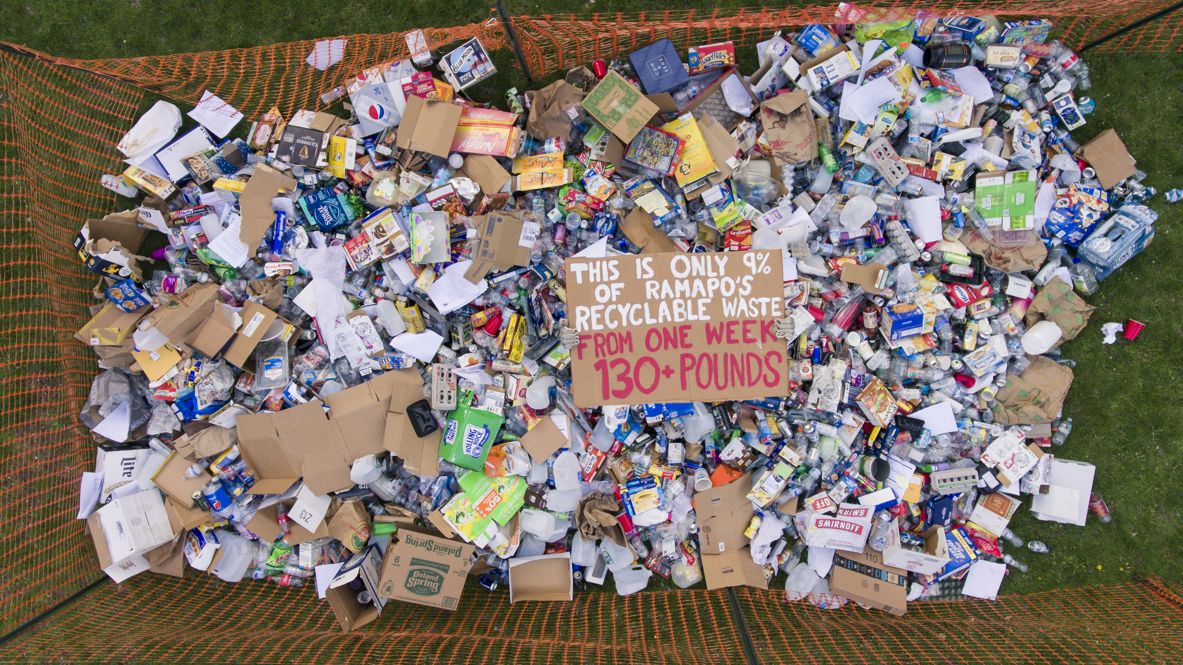 "Students Dumps ""Recycable"" Waste On College's Front Lawn In A Bold Statement"