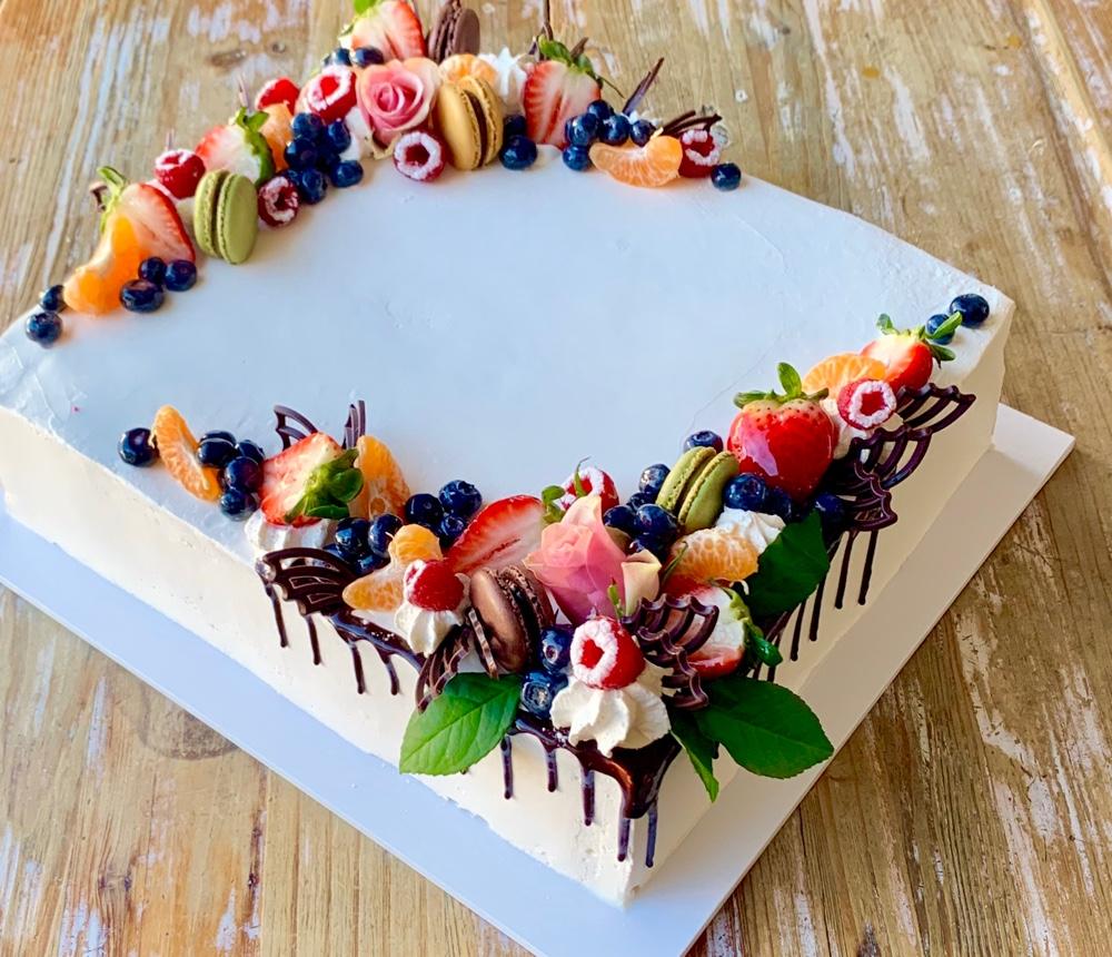 Fruit Designer Decorates A Cake