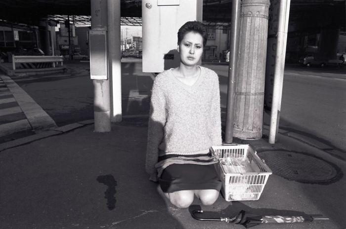 Woman Kneeling In Street. 1980