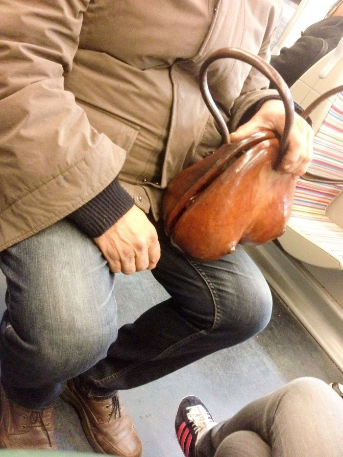 This Guy Had An Interestingly-Shaped Wooden Hand Bag In The Subway