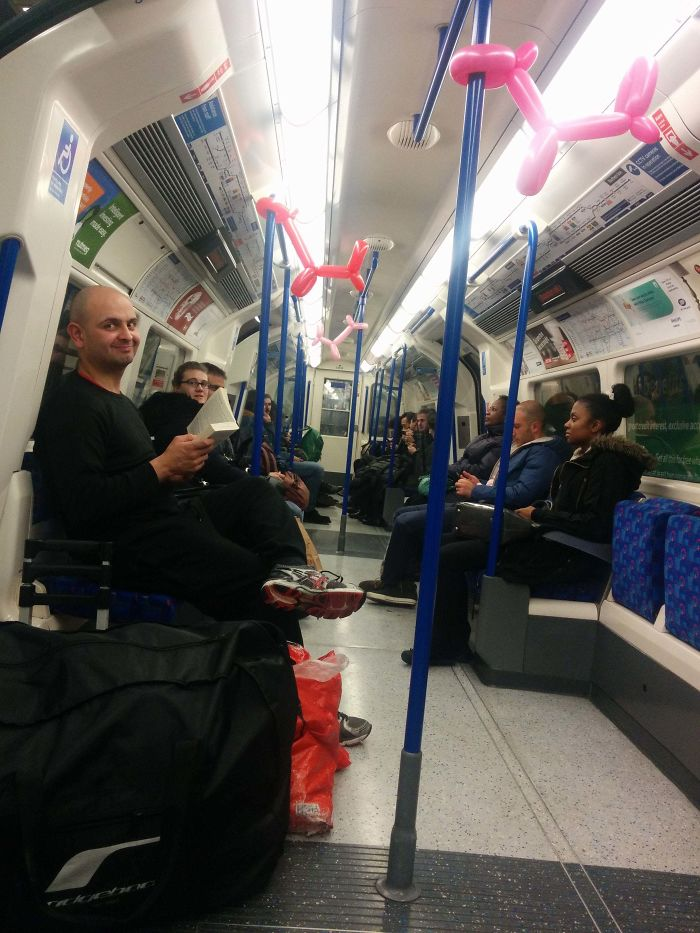 """The Tube's Infamous """"Balloon Bandit"""". He Makes Balloon Animals And Quickly Goes Back To His Book"""