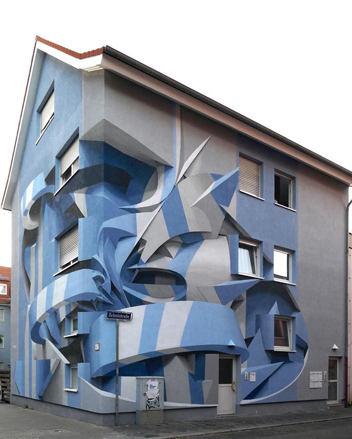 فنان يذهل المارة برسوماته التجريدية ثلاثية الأبعاد