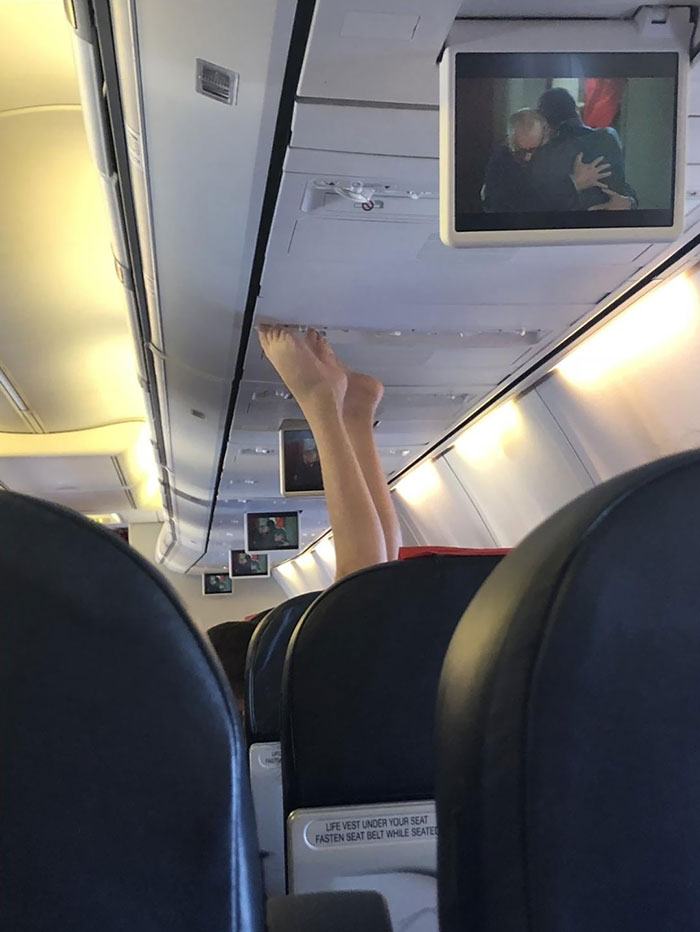 Woman Puts Her Nasty Feet On Airplane Ceiling Where Air Conditioning Is