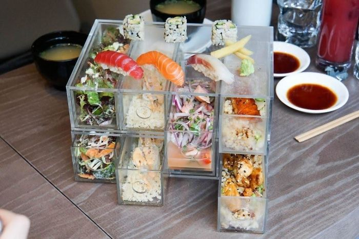 Sushi, Sides And Mains Served In IKEA Style Organisers Because Plates Aren't Orderly Enough And Bento Boxes Are Too Common.