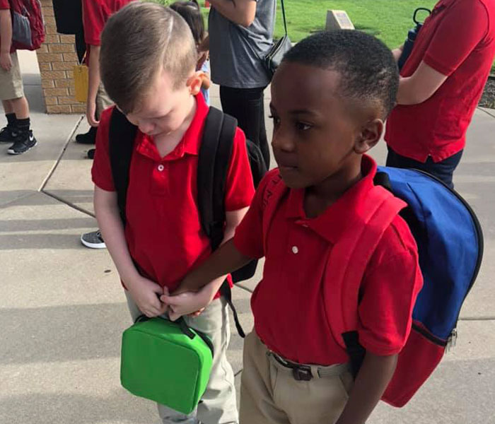 This 8 Y.O. Boy Saw An Autistic Boy Crying On The First Day Of School, Grabbed His Hand And Walked Him To Class