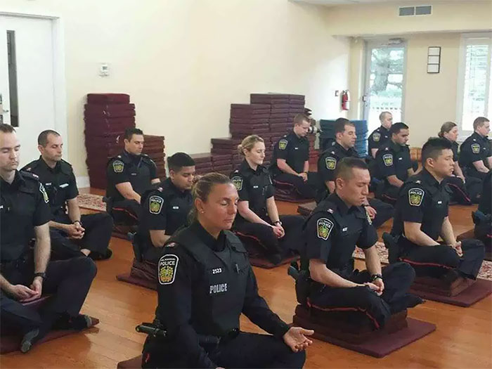 Canadian Police Officers Meditating Before They Start Their Day