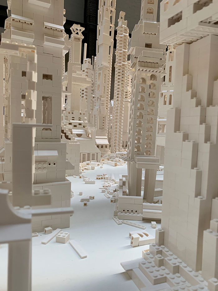 A City Is Being Built With White Lego Pieces And Everyone Can Join The Process