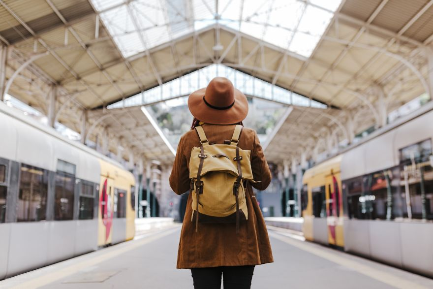 The Young Caucasian Woman At The Train Station