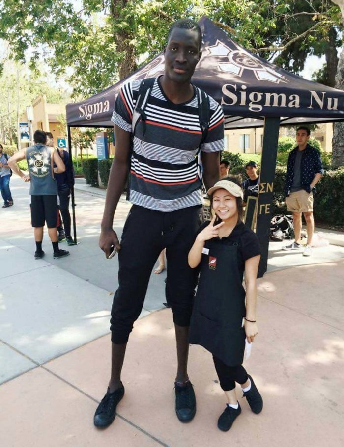 This Tall Man And Short Woman