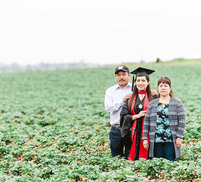 Graduate Takes Powerful Photo With Parents In The Fruit Field They Worked In To Give Her A Better Future