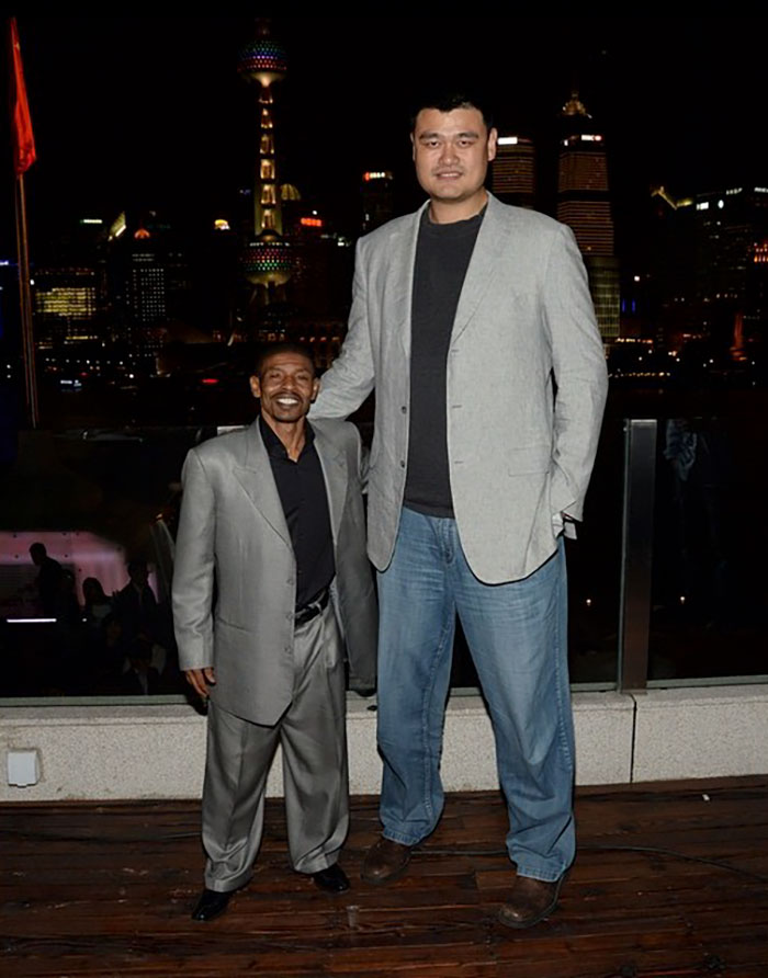 Yao Ming And Retired American Basketball Player Muggsy Bogues