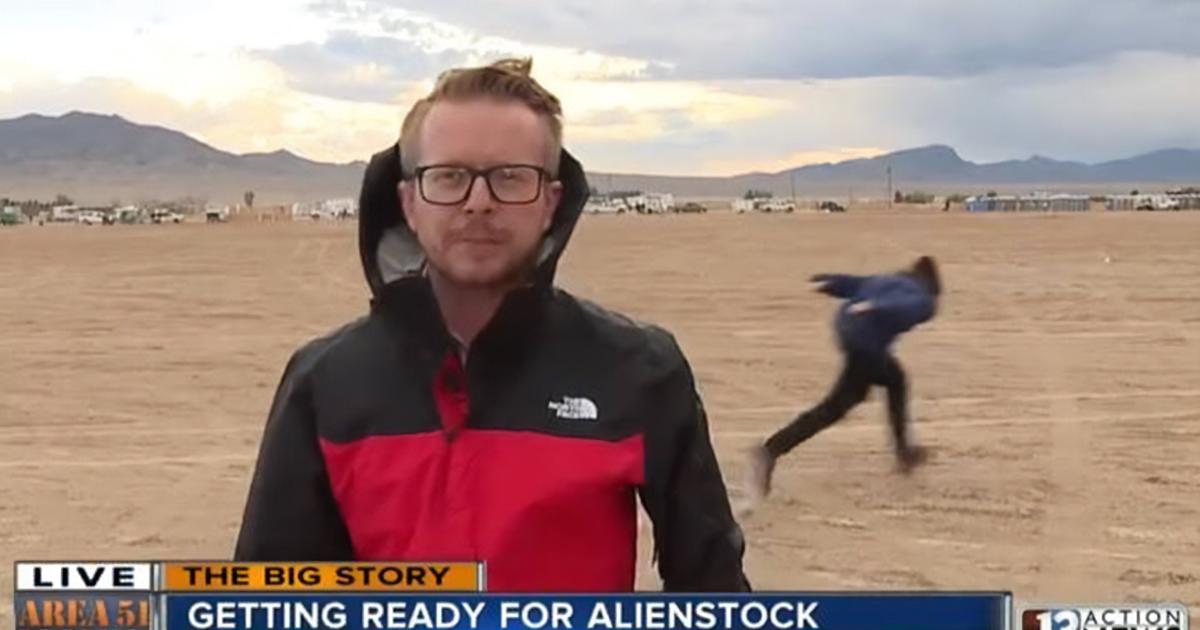 Man Does A Naruto Run Past A TV Reporter As People Gather To Storm Area 51