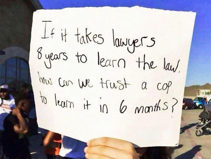 Person Puts Up A Sign About Police Officers' Legal Knowledge And It Starts A Heated Discussion