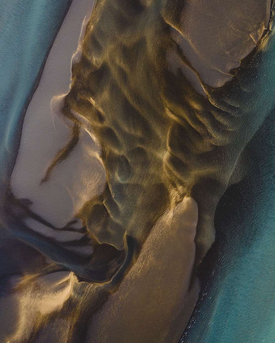 Drone Photo Of Sulfur River Merging With Fresh Water Coming Down From A Melting Glacier