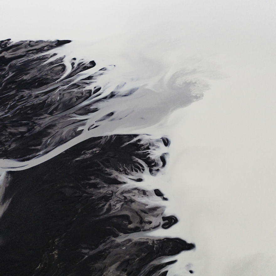 Drone Photo Of Glacial Rivers Cutting Through Black Volcanic Soil