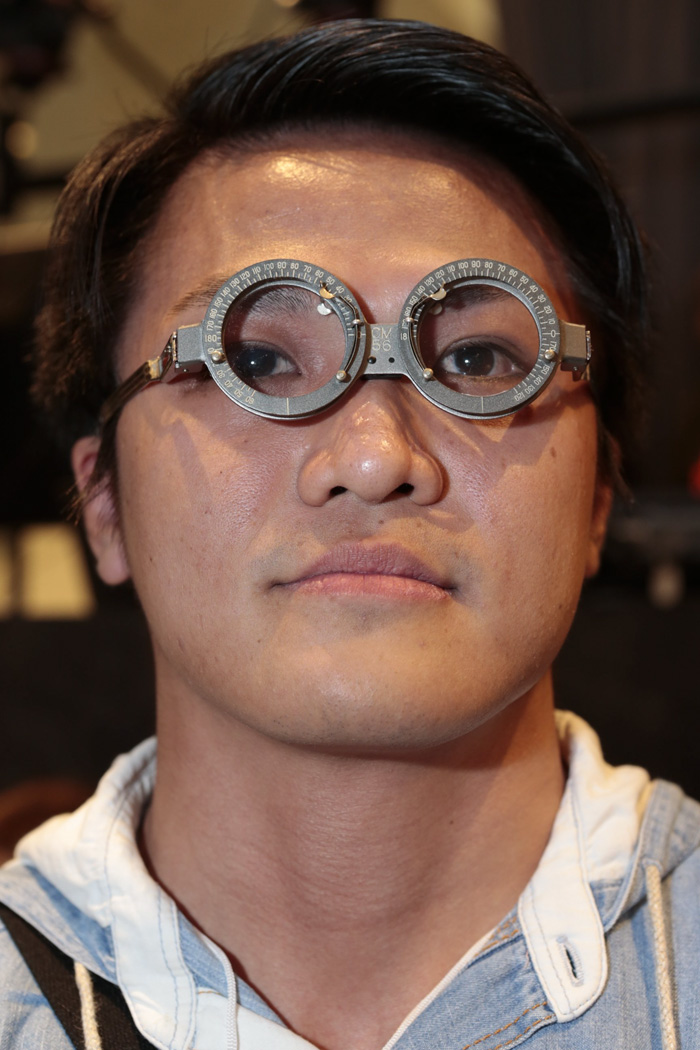 A Person In The Middle Of Making Glasses