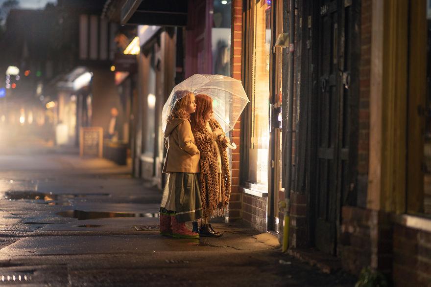 Locksbottom, UK - Girls Looking At A Shop Window In The Rain