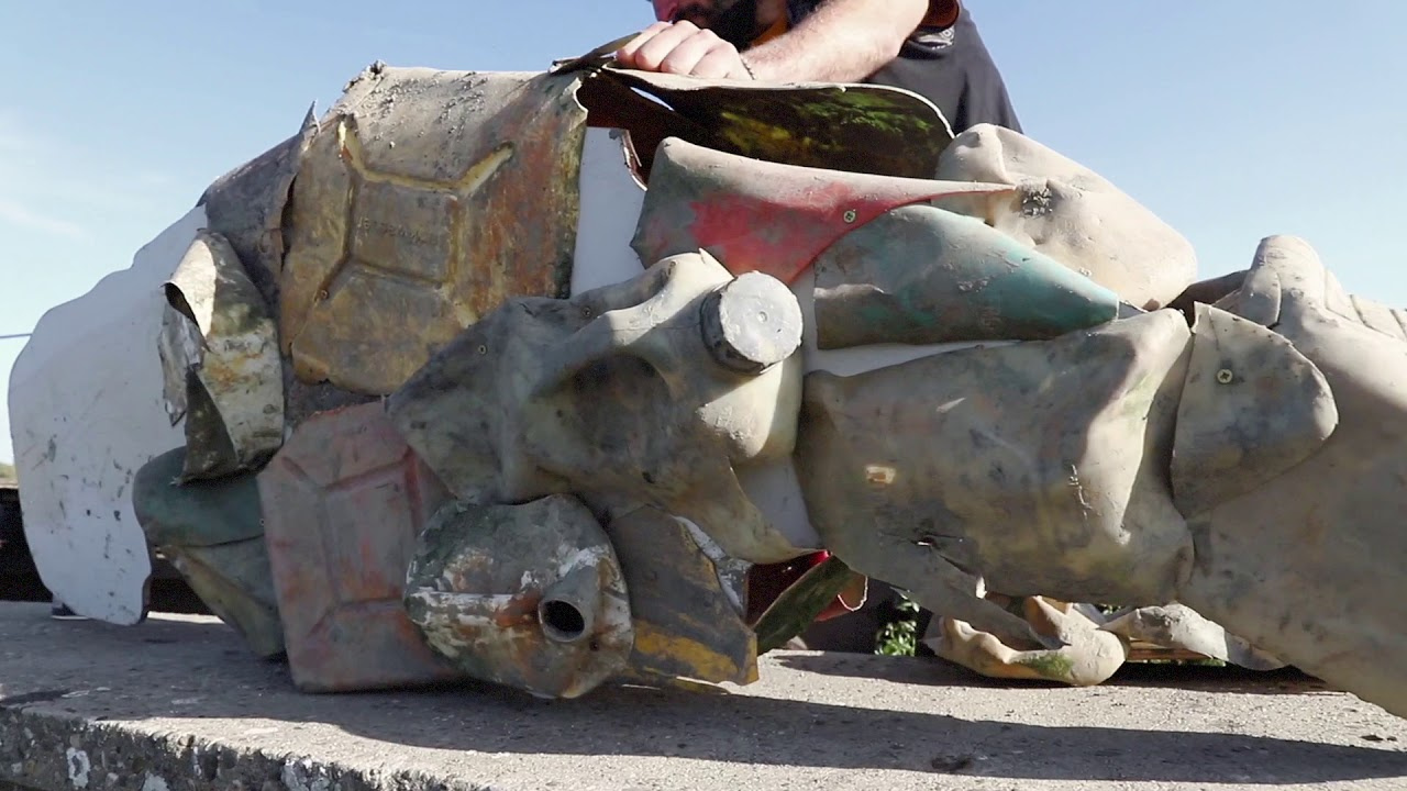 Artist (Feoflip) From Canary Islands Builds Trashosaurus In The Scheldt River Next To Antwerp City As A Symbol For River Cleanup Day.