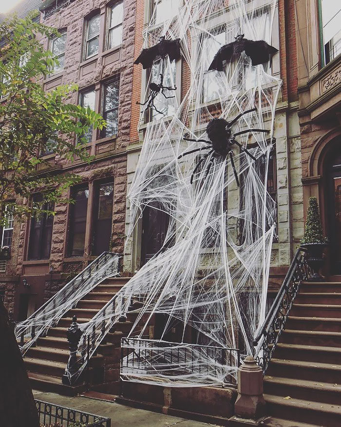 You Know It's Halloween In New York When People Cover Their Apartments In Giant Spiderwebs