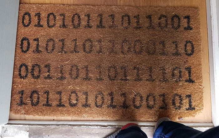 """This Doormat Which Says """"Welcome"""" In Binary"""