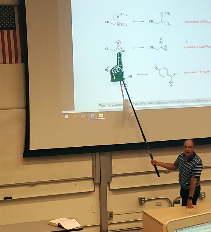 My Professor Doesn't Believe In Laser Pointers So He Uses A Fishing Pole With A Foam Finger Attached And I Can't Contain Myself During A Lecture
