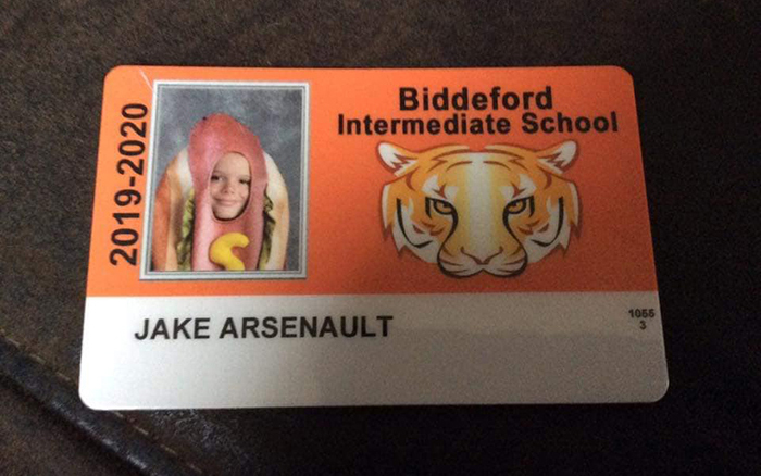 Parents Find Out That School Allows Kids To Wear Hot Dog Costumes For Their ID Photo, So They Dare Their Son To Do It